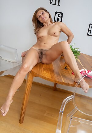 Mature amateur housewife shows off her lovely hairy pussy