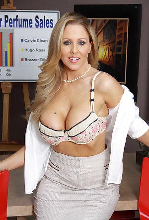 Busty office worker Julia Ann