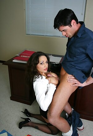 Busty secretary Isabella Manelli has doggy sex with an janitor