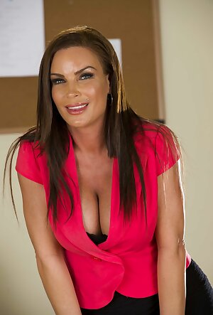 Sexy mature secretary Diamond Foxxx does a naughty striptease in her office