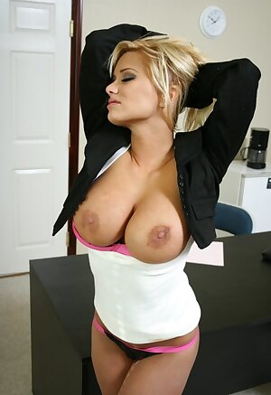 Naughty businesswoman Shyla Stylez shows off her big tits at the office
