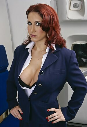 Naughty redhead air hostess Kylee Strutt shows her big boobs