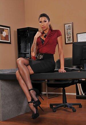Tall Latina MILF Kayla Carrera displays her tattooed body and round ass