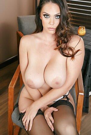 Astonishing wife Alison Tyler displaying her huge tits while wearing black stockings