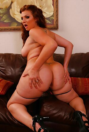 Natural redhead BBW Ava Rose poses nude