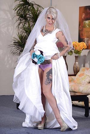 Inked bride Kleio Valentien undressing and posing nude