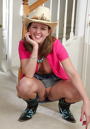 Mature cowgirl shows off her pussy
