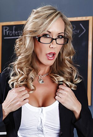 Busty mature teacher Brandi Love shows her big tits