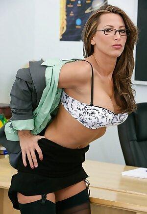 Horny MILF teacher Lezley Zen does classroom stripper routine to finger on her desk