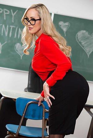 Perfect mature teacher Brandi Love showcases her naked cunt