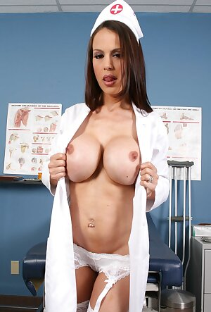Seductive nurse with big tits McKenzie Lee poses on the doctors table