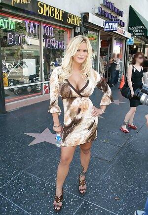 American MILF pornstar Shyla Stylez in dress  posing on the avenue of stars