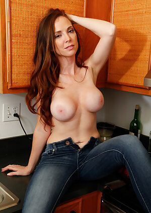 Petite redhead housewife Jessica Rayne strips in the kitchen