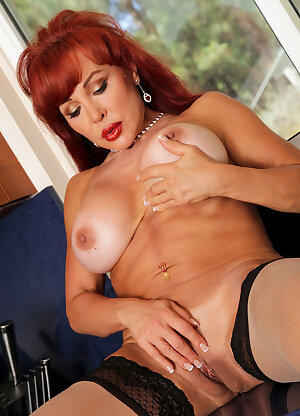 Redhead housewife Vanessa Bella fingers her pink in the kitchen