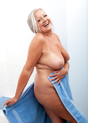 Grey haired granny April Thomas fingers her clam