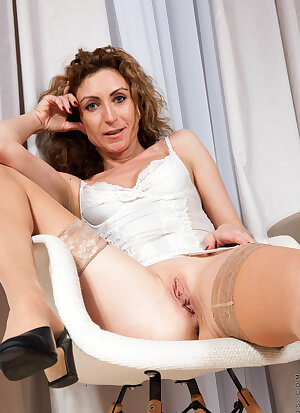Petitte mom Dafna May unveils her small tits and shaved pussy