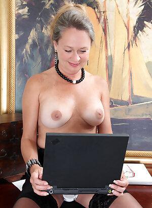 Mature boss shows her big juggs and masturbates at work