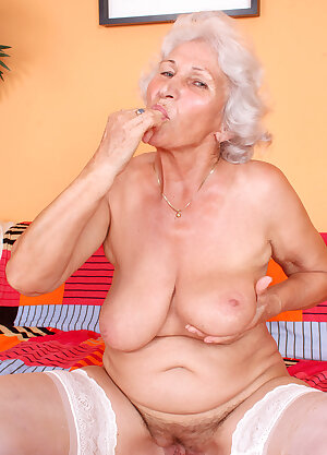 Grey haired granny exposes her saggy juggs