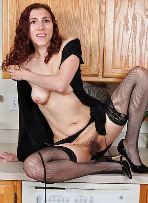 Amateur housewife next door masturbates at the kitchen