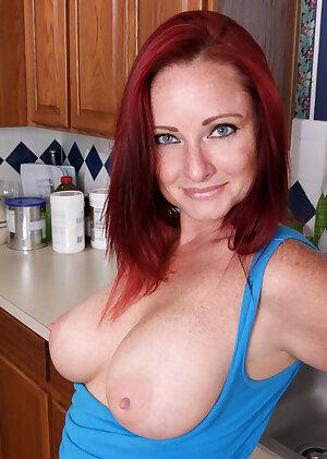 Amateur redhead housewife Sandi Lymm strips in kitchen