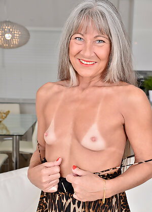 Grey haired granny Leilani Lei shows her tiny tits with tan lines