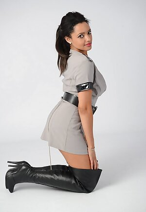 Gorgeous correction officer wearing a pair of sexy leather boots