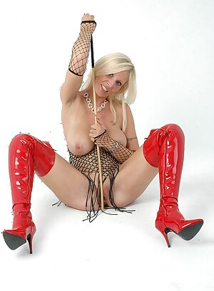 Horny MILF in long slutty red thigh high leather boots