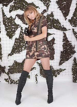 Army girl dressed in her long black leather boots