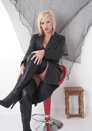 Blonde UK model teases in just her bra and thigh high leather boots