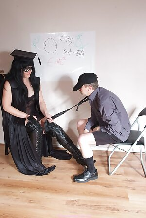 Mistress teachers is in class with her big black knee high leather boot