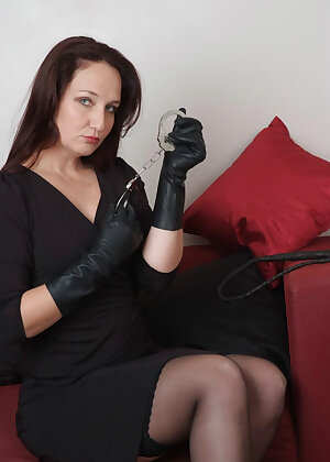 Sexy wife has her paddle out with her handcuffs ready for some leather fun with her gloves on