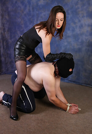 Dominant mistress has her sexy leather gloves on