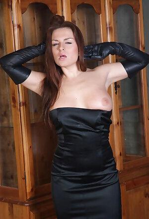 Brunette MILF loves showing off her leather gloves