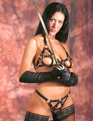 Sultry looking Mistress in sexy leather gloves