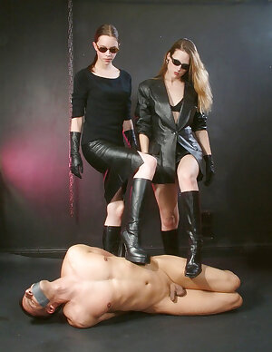 Very hot femdoms in sunglasses and leather outfits