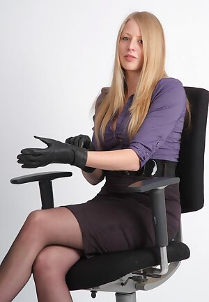 Leggy office babe puts on a tight black pair of leather gloves