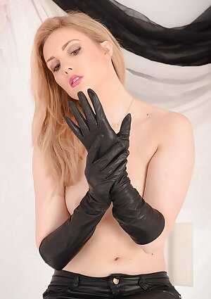 Lovely MILF blonde is in tight leather pants and a pair of long soft leather gloves