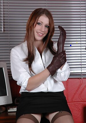 British secretary puts on her sexy leather gloves