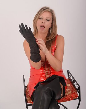 Brit MILF in full leather gear putting on her soft delicate leather gloves