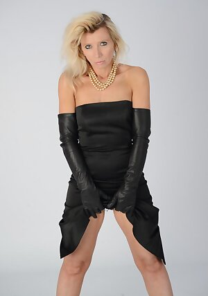 Horny lady is all alone in her black dress wearing her kinky full length leather gloves