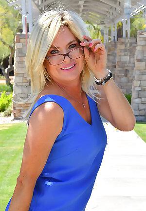 Elegant blonde flirts in blue dress
