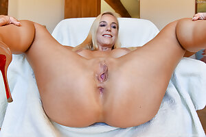 Blonde slut Sophia West spreads her pussy