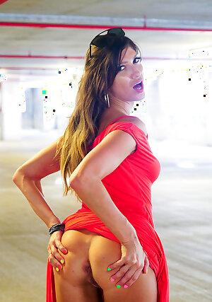 Stunning MILF Karina spreads her tight ass in red dress