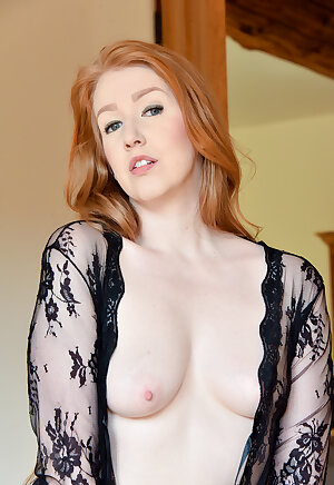 Curvy redhead wife posing in lacy sheer and black lingerie
