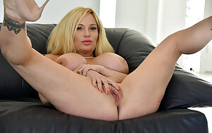 Flirty MILF babe Tyler Faith with giant tits spreading shaved pussy