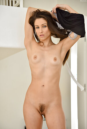 Skinny MILF with hairy pussy posing nude at home