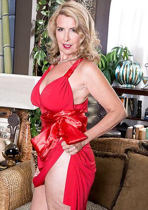 Elegant busty super-mom Laura Layne teases in red dress