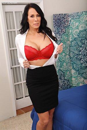 Busty MILF pornstar Reagan Foxx undresses after work at the office