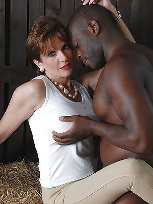 Horny UK MILF with big tits teasing and jerking a big black dick