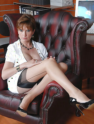Desirable mature sex therapist in nylons flashing her hairy pussy